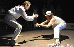 Greg Hicks (left), as the corrupt police chief Gordilho, gets a capoeira lesson from Carlo Alexandre Teixeira Da Silva
